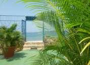 casa al fronte de la playa