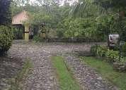 Terreno con casa en construccion